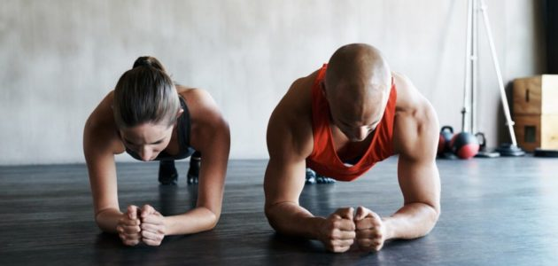athletes doing a plank